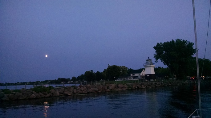 Moonlit Cruise by the Oak Orchard Lighthouse by Lynne Menz Designs